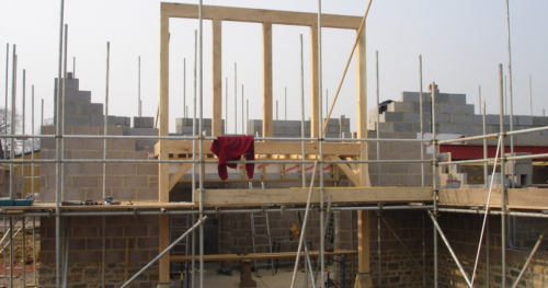 House under construction showing green oak framing
