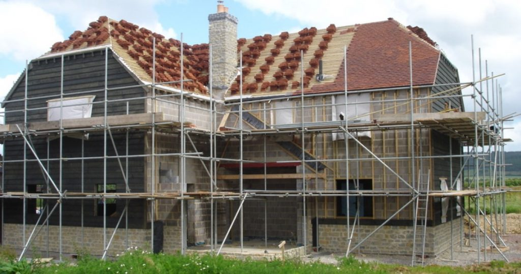 House under construction tiling roof